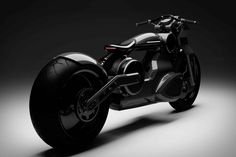 Curtiss revealed the futuristic Zeus jet-black electric motorcycle. Built on an aluminum frame, the Curtiss Zeus motorcycle, features solid carbon wheels. The Zeus powered by 190 horsepower will have… Bobber Bikes, Bobber Motorcycle, Motorcycle Design, Girl Motorcycle, Motorcycle Quotes, Blade Runner, Futuristic Motorcycle, Motorcycle Companies, Mens Gear