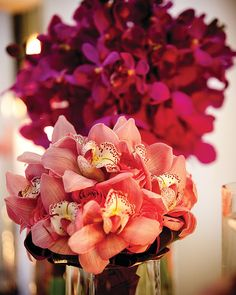 Separate bouquets of pink and purple orchids contrast beautifully, sitting next to each other at @Four Seasons Hotel Toronto.