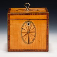 Satinwood Tea Caddy (England) A fine Georgian tea caddy, satinwood with tulip-wood cross-banding to the edges, inlaid top and front with oval fans, circa 1780 w.4.5 in x d.3.75 in x h.4.25 in