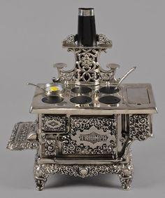 Kenton cast iron, nickel, and tin Triumph toy stove, 15 1/2'' h., 15 1/2'' w.