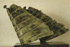 Tjikkie Kreuger (1941), Windgodinnnen (1991), brons, 40 x 18 x 38