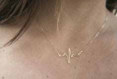 Heartbeat necklace....I would like to have one with an elevated ST segment, representing Brugada Syndrome.