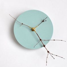 Irina Nina Witkiewicz is an interdisciplinary Product Designer based in Berlin. She created the 'Zweigwerk Clock' featuring tender branches in a brass mount that dance for hours and hours on the branch clock. They vibrate and tremble, intersect and separate again – a small-time spectacle.
