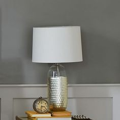 Metallic Honeycomb Table Lamp #westelm.   I would change out the table lamp in the foyer as well.
