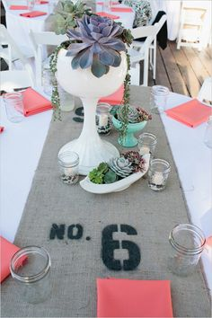 burlap table runner with stenciled table numbers & succulent centerpieces