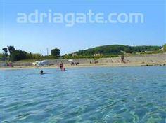 Sandy beaches - A guide to the beaches  Bilin Zal beach, South Dalmatian islands, Lumbarda - island Korcula, sandy and concrete slabs