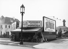 """(ca. 1928) - Close-up of one of the many """"Wilshire Special"""" streetlights that were prevalent along Wilshire Boulevard during the late 1920s and 1930s."""