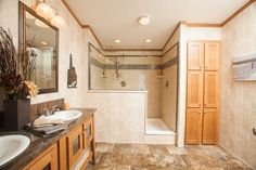 Commodore Homes of Pennsylvania 3A241A  - Astro Ranch Master Bathroom with dual sinks, 4'x6' walk-in ceramic tile shower, and great storage linen cabinet!