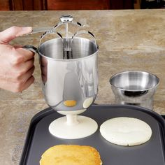 Stainless Steel Pancake Dispenser with Holder Dispense precise amounts of pancake, waffle or crepe batter, drip-free. $15.95