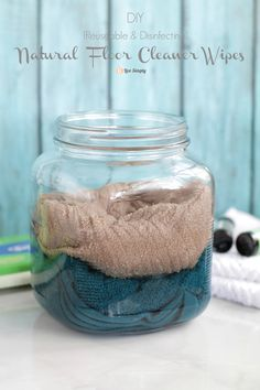 DIY Natural Floor Cleaner Wipes Recipe- Use washcloths to make DIY cleaning wipes: reusable, easy to wash, and natural. Simply attach a DIY Natural Floor Cleaner Wipe to a Swiffer base and clean the floor like its never been cleaned before.