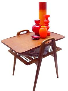 Danish Modern Tiered Table. I soo remember this with the shag rugs!
