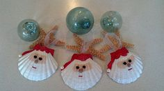 Beach decor seashell Santa Christmas ornament. I have painted tiny seashells black for the eyes, and for the mouth a natural seashell. These shell ornaments are beautiful hanging on the Christmas tree, but dont stop there! They are also stunning on gift packages They measure between 3.5-4.0 diameter, but each is unique and they will not be identical.