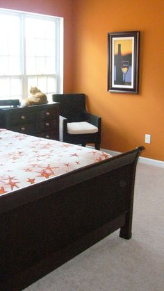 Orange bedroom. Looks good with black furniture, which I have.....hmmmm