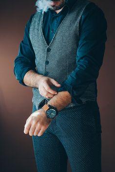 Man Adjusting Sleeves While Smoking - https://www.splitshire.com/man-adjusting-sleeves-smoking/