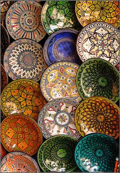 In the Marrakech souks, you can find these brightly painted large plates for sale. Marvelous designs....