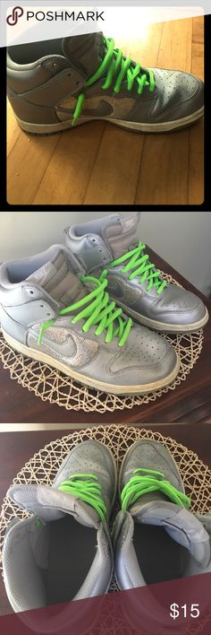 Silver Nike high tops Silver Nikes with sparkley section around the Nike swoosh. Worn a lot but overall in good condition. White section needs to be cleaned. Will not clean before selling. Nike Shoes Sneakers