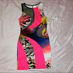 NWT BODYCON DRESS SZ MEDIUM BRAND NEW WITH TAGS SIZE MEDIUM DRESS. HAS BLACK MESH CLOSE UP IN 3rd photo. VERY COLORFUL AND HAS A BIT OF SNAKE SKIN PRINT ALSO. VERY STRETCHY! CHEAPER ON MERCARI Dresses Mini