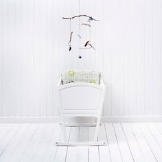baby cradle with bird mobile