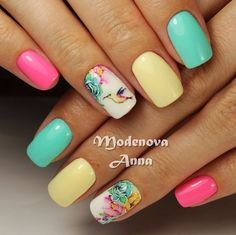 Multicolored rose nail art design. The pastel colors combined together make the ail art design look sweet and charming. Each nail is in different pastel colors which make the entire design look cute and pleasant.