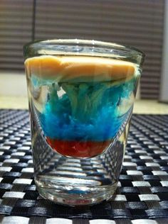 Any drink that looks like an intense storm cloud forming is good enough for me to drink. Apparently, this is called a Brain Hemorrhage? Tastes really good when the Peach Schnapps and Bailey's Cream are mixed together. Strong, but not Vodka/Jack Daniels strong.