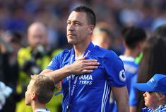 258783901dd John Terry of Chelsea pats the Chelsea badge on his shirt after the Premier  League match