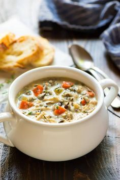 Slow Cooker Creamy Chicken and Wild Rice Soup. A healthy, EASY creamy chicken and rice soup that tastes just like Panera! Make in the crockpot or the Instant Pot.
