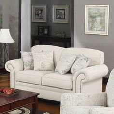 """Nailhead-trimmed loveseat with linen-blend upholstery and a wood frame.   Product: Loveseat and four throw pillowsConstruction Material: Wood, foam and linenColor: IvoryFeatures:  Nailhead trimThrow pillows included20"""" Seat height Dimensions: 36"""" H x 67"""" W x 35"""" D"""