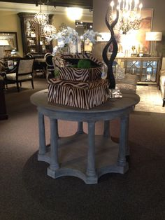 If you have a large entryway with tall ceilings, a great way to fill the space is with a round entryway table. Then create height on the table with your accessories to fill the vertical space as well!