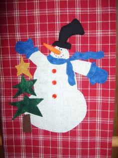 Snowman and star tree appliqued towel.