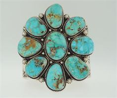 Sterling silver cuff with 9 turquoise stones. By Navajo artsit Mike Thompson.