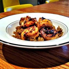 "Chef John's New Orleans-Style Barbequed Shrimp  ""This indigenous American shellfish dish, cooked on the stovetop, has plenty of big flavors from garlic, rosemary, and freshly cracked black pepper. Serve over hot cooked rice. Use the largest shrimp you can get."""