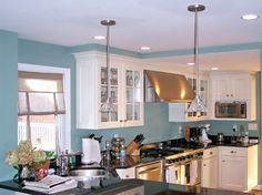 Image result for kitchen blue walls white units