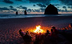 The best weekend ever would start out as a campout on the beach at sunset on Friday night complete with a fire and some good music. (haystack rock / jon martin)