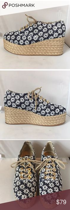 ANTHROPOLOGIE NEW 37 Denim flower espadrilles Angela Scott for ANTHROPOLOGIE NEVER WORN $428 RETAIL!  NAVY DENIM ESPADRILLES WITH WHITE DAISIES RAFFIA COVERED PLATFORM WEDGE SOLES RAFFIA LACES 2.5 inch heel  **PLEASE SEE PHOTOS. BACK OF RIGHT SHOE IS SLIGHTLY DISCOLORED, SOLE IS SCUFFED AND THERE IS A SMALL SHALLOW HOLE IN SOLE  (does NOT  go through the sole!) THAT CAN BE EASILY FILLED BY A SHOE MAKER.               DUST BAG AND BOX INCLUDED Anthropologie Shoes Espadrilles
