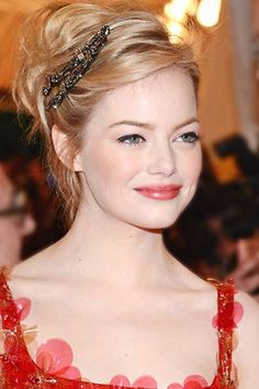 Emma Stone's doll-like updo. See it and 23 other wedding-ready hairstyles.