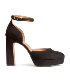 Pumps in imitation suede with an adjustable strap that circles ankle twice. Covered platform and heel, imitation leather lining, and rubber soles. Platform front height 1 in., heel height 4 1/2 in.