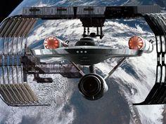 The Enterprise leaving a space dock