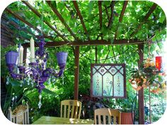 sunshine - moonshine: Glamorous patio with purple chandelier and stained glass surrounded by urban farm/garden