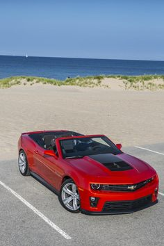 2013 Chevrolet Camaro ZL1 Convertible.. The Americans said wait a minute it has 4 separate wheels.. What if we treated them all sort of.. Separatly?!