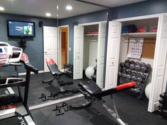 make your home gym work in a small room - movable bench, foldable treadmill, TV/speakers off floor, dumbbells/accessories in closet, LED recess lighting to keep the room cool