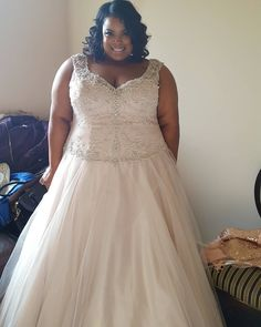 This plus size wedding dress has beading on the bodice. You can have our American company recreate this type of bridal gown for you with any changes you need. We specialize in affordable custom plus size wedding dresses for brides of all sizes. You can also have #replicaweddingdresses and discontinued gowns created for you at www.dariuscordell.com/