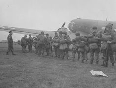 Members of the 82nd Airborne Division having their gear checked by the jumpmaster for the last time before entering their C-47 Dakotas for the Market Garden operation at Cottesmore airfield England 17 September 1944.