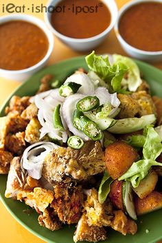 Singapore Street Food - Indian Rojak. Mainly made up of deep fried dough fritters, bean curd, prawn fritters and hard boiled eggs paired with sweet and spicy Chilli sauce.