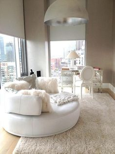Glam,Feminine decor,round couch and mirrored furniture...  Bianca... Maybe Chic/Glam is what I'm going for!!!