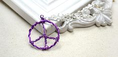 Easy Instructions on Making a Wire Wrapped Peace Sign Pendant for Girls