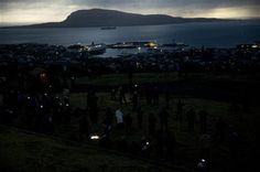 People watch in darkness during the totality of a solar eclipse on as seen from a hill beside a hotel on the edge of the city overlooking Torshavn, the capital city of the Faeroe Islands, Friday, March 20, 2015. (AP Photo/Matt Dunham) ▼20Mar2015AP|Ring of light: Total eclipse over Svalbard islands in Arctic http://bigstory.ap.org/article/b6d4cc2912cc4b72b9a4ac6df1f229e0