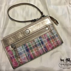 """Coach Wristlet Coach Madras Plaid wristlet.  Has one """"C"""" in clear sequins on the front & 2 on the back.  About 7 1/2"""" long, 4 1/2"""" tall, 3/4"""" when zipped. A full length pocket on outside back. No stains or tears. Comes with dust bag. Smoke free home. Coach Bags Clutches & Wristlets"""