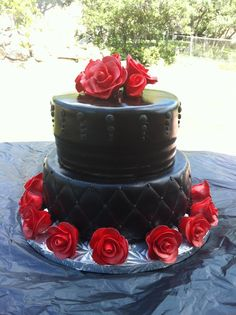 Choc cake with choc ganache covered in choc fondant. Roses are also fondant.