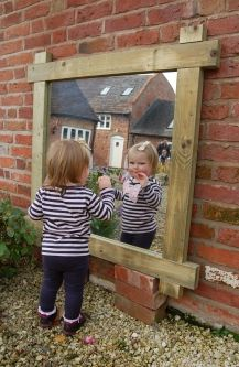Put a mirror anywhere and dance in front of it! Placing manufactured materials into an outdoor space encourages children to combine natural materials and pre-made materials into their play. This mirror helps encourage socio-emotional and dramatic play. Outdoor Learning Spaces, Outdoor Play Areas, Eyfs Outdoor Area, Outdoor Games, Indoor Outdoor, Natural Playground, Outdoor Playground, Playground Ideas, Natural Play Spaces