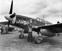 """Mustang Friday: 2nd Lt Jack Carr in front of North American P-51B-5 Mustang 43-7065 GQ-W """"Wild Bill"""". In the background stands P-51B """"Ding Hao !!, the mount of Lt Col. James Howard, CO of the 354th Fighter Group. Jack Carr and """"Wild Bill"""" set out on a mission from Station AAF-410 formerly RAF Lashenden and failed to return 25th April 1944."""